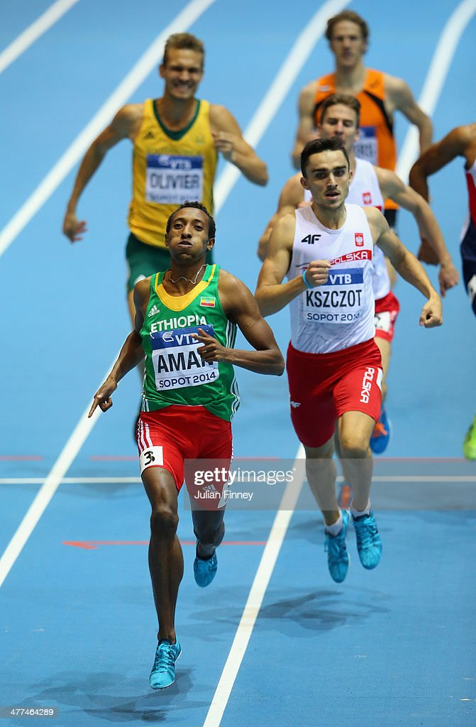 <a gi-track='captionPersonalityLinkClicked' href=/galleries/search?phrase=Mohammed+Aman&family=editorial&specificpeople=7149144 ng-click='$event.stopPropagation()'>Mohammed Aman</a> of Ethiopia competes on the way to winning the gold medal with silver medalist <a gi-track='captionPersonalityLinkClicked' href=/galleries/search?phrase=Adam+Kszczot&family=editorial&specificpeople=5746296 ng-click='$event.stopPropagation()'>Adam Kszczot</a> of Poland in the Men's 800m Final during day three of the IAAF World Indoor Championships at Ergo Arena on March 9, 2014 in Sopot, Poland.