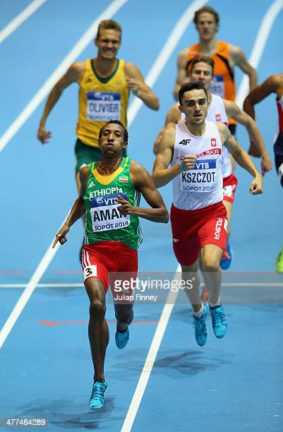 Mohammed Aman of Ethiopia competes on the way to winning the gold medal with silver medalist Adam Kszczot of Poland in the Men's 800m Final during...