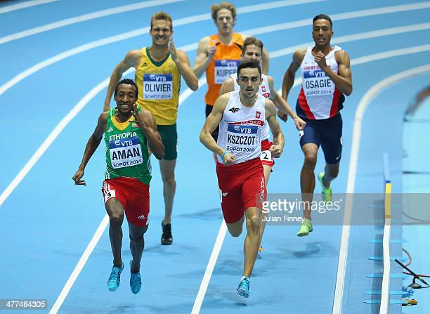 Mohammed Aman of Ethiopia competes on the way to winning the gold medal with silver medalist Adam Kszczot of Poland and bronze medalist Andrew Osagie...