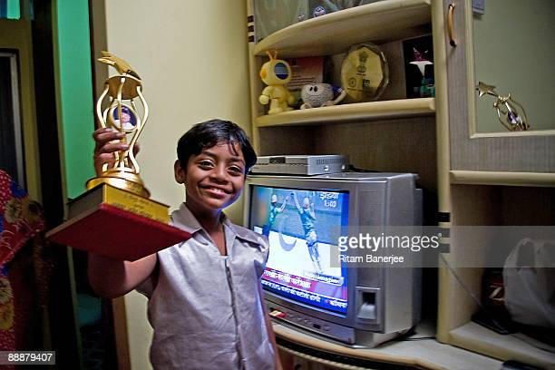 Mohammed Azharuddin Ismail child star of the Oscar winning 'Slumdog Millionaire' celebrating his newly allocated 250 square foot apartment by 'Jai...