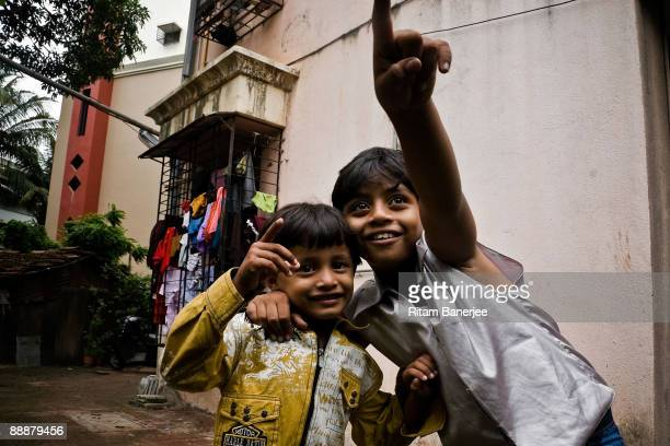 <Mohammed Azharuddin Ismail child star of the Oscar winning 'Slumdog Millionaire' celebrating his newly allocated 250 square foot apartment by 'Jai...