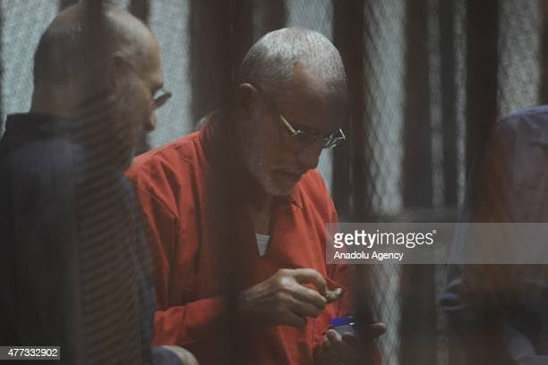 Mohammed Badie Supreme Guide of the Muslim Brotherhood seen inside a cage in the courtroom where he stood trial during the trial in Cairo on June 16...