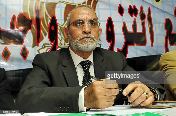 Mohammed Badie the head of Egypt's Muslim Brotherhood holds a press conference in Cairo on November 9 with members of different Egyptian political...
