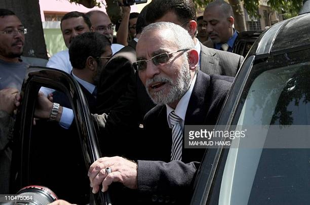 Mohammed Badie the head of Egypt's Muslim Brotherhood leaves a polling station in Cairo after casting his vote on March 19 2011 as voters got their...