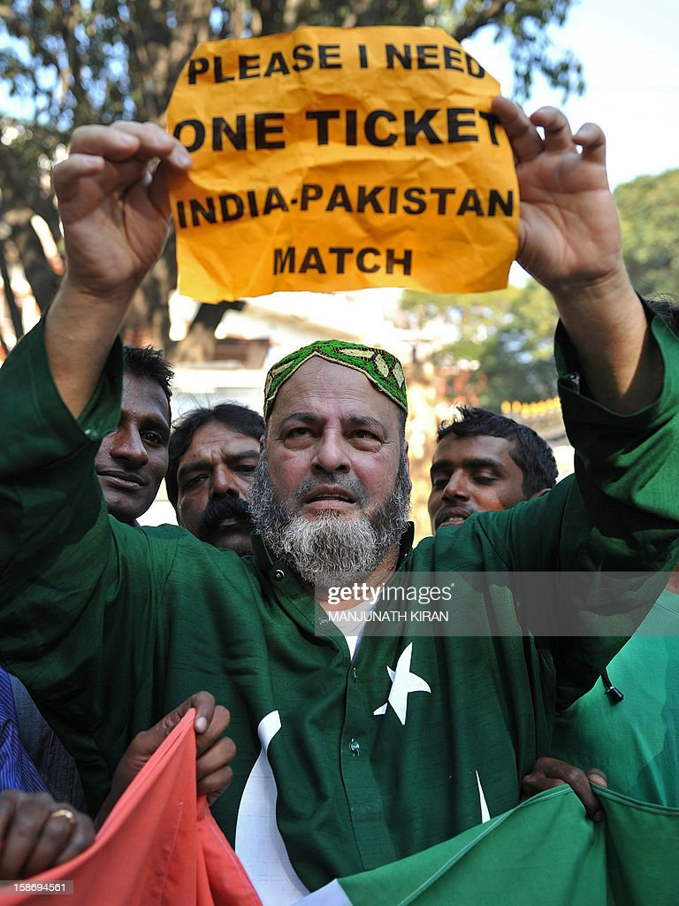 Mohammed Bashir, a 60-year old US-based Pakistani cricket fan, holds up a placard seeking a spare ticket on the eve of the India-Pakistan cricket series in Bangalore on December 24, 2012. Few Pakistani fans had made it to Bangalore on December 24 but one who had travelled from the United States said that it was too much to expect cricket to serve as a propeller for diplomacy every time the teams played. AFP PHOTO/Manjunath KIRAN