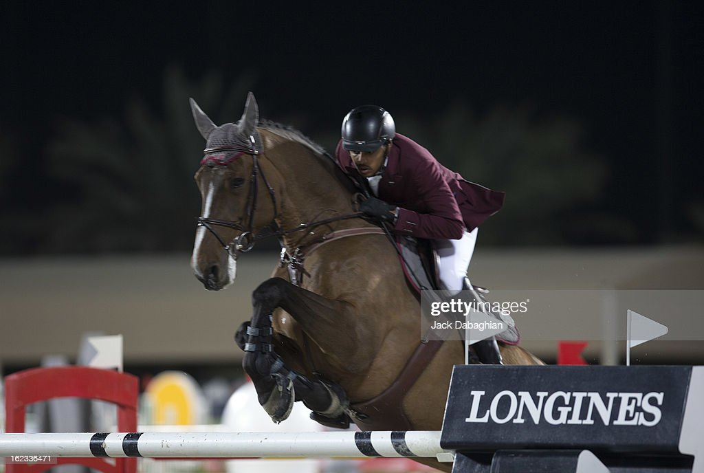 Mohammed Bassem Hassan of Qatar clears a hurdle on Rosalia La Silla during the President of the UAE Showjumping Cup - Furusyiah Nations Cup Series presented by Longines on February 21, 2013 in Al Ain, United Arab Emirates.