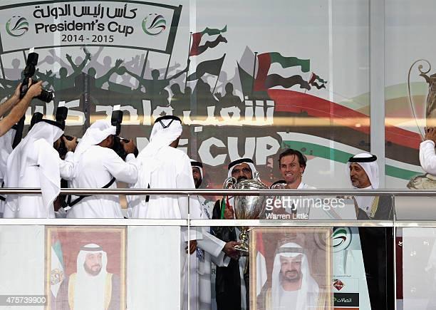 Mohammed bin Rashid Al Maktoum Ruler of Dubai and Vice President of the UAE awards the trophy to Al Nasr Captain Brett Holman after winning the the...