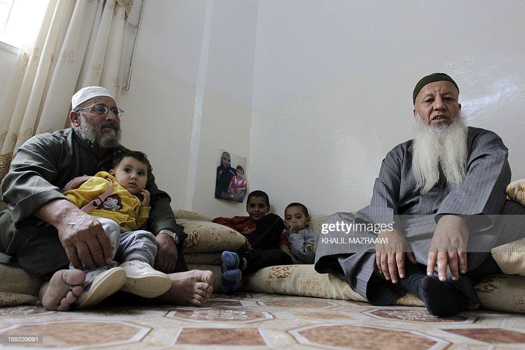 Mohammed (L), Father of of Jordanian of Palestinian origin Salafist, Mahmud Abdelal, who blew himself up in the Syrian city of Daraa last month, sits in his house with his son's father-in-law and top Salafist leader in Jordan, Abed Shehadeh, known as Abu Mohammad Tahawi (R) in the Baqaa Palestinian refugee camp, north of Amman, on November 1, 2012. Tahawi said more than 250 Jordanian jihadists are now in Syria to fight and that 13 others have been killed there.