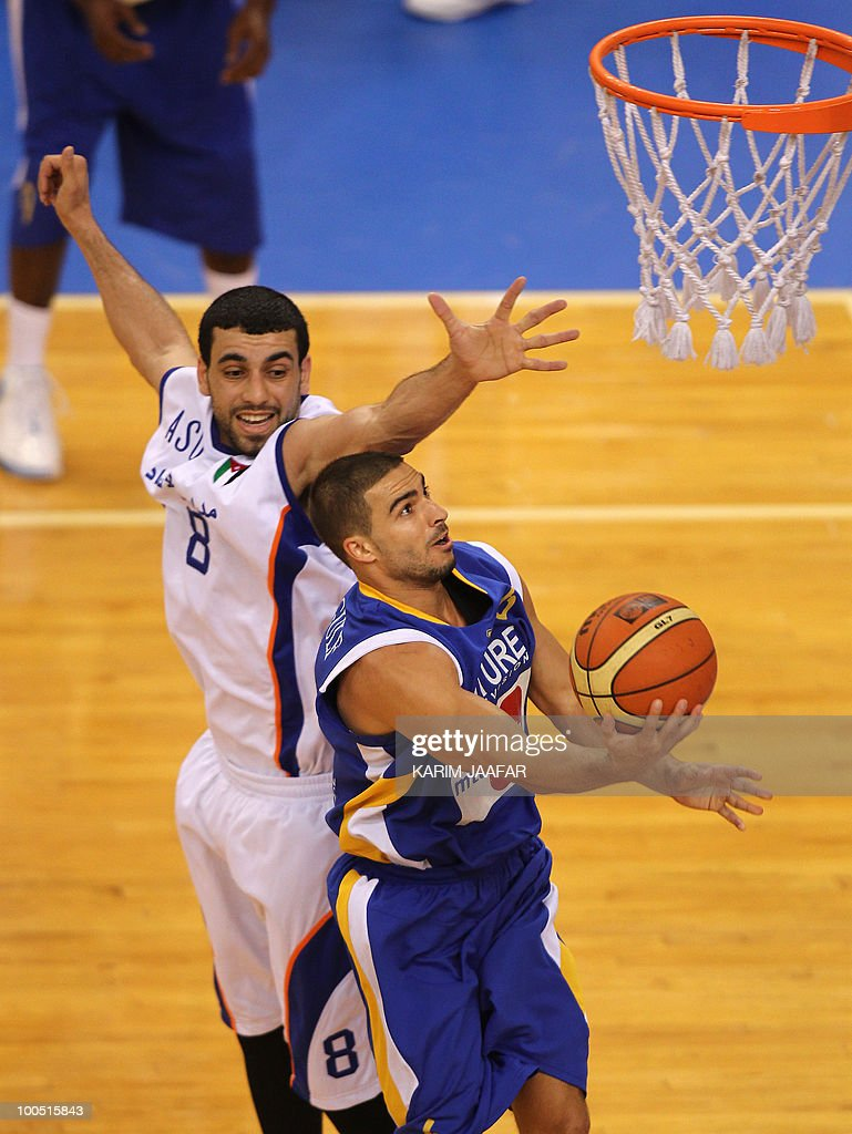 Mohammed Hadrab of Jordan's ASU club (L) tries to block Ali Mahmud of Lebanon's Al-Riyadi (R) as he heads to the basket during their 21st FIBA Asia Champions Cup basketball match at Al-Gharafa Indoor Stadium in Doha on May 25, 2010.