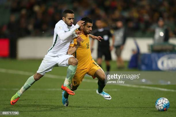Mohammed Ibrahim Alburayk of Saudi Arabia tackles Aziz Behich of Australia during the 2018 FIFA World Cup Qualifier match between the Australian...