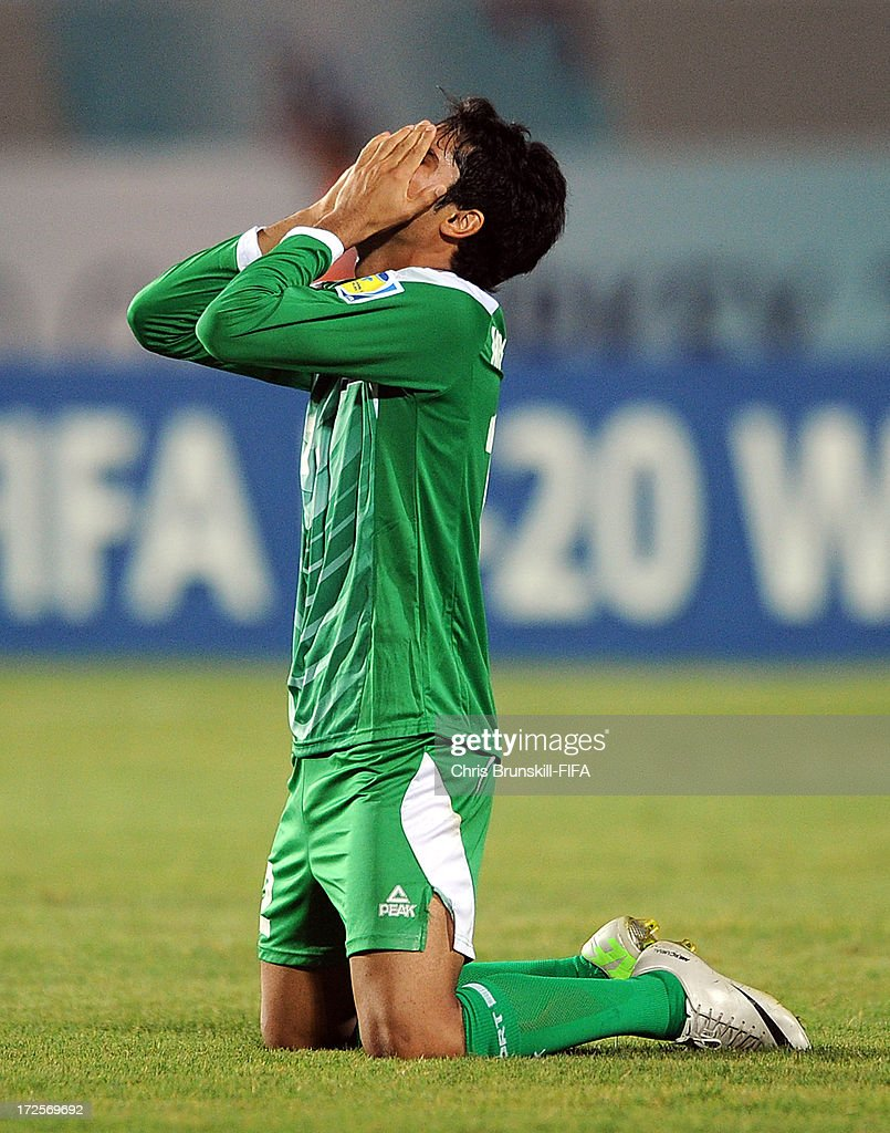 Mohammed Jabbar Arebat of Iraq celebrates at full-time following the FIFA U20 World Cup Round of 16 match between Iraq and Paraguay at Akdeniz University Stadium on July 03, 2013 in Antalya, Turkey.