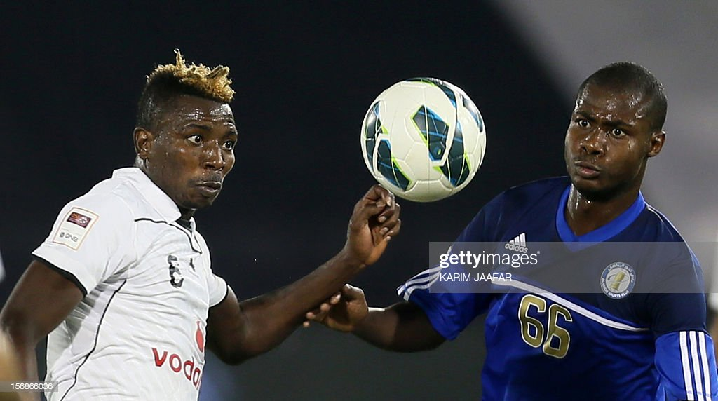 Mohammed Kasoula (L) of Qatar's Al-Sadd fights for the ball against Usman Mohamed (R) of Al-Khor during their Qatar Stars League football match in Doha, on November 23, 2012. Al-Sadd won 2-1. AFP PHOTO/KARIM JAAFAR/ AL-WATAN DOHA== QATAR OUT ==