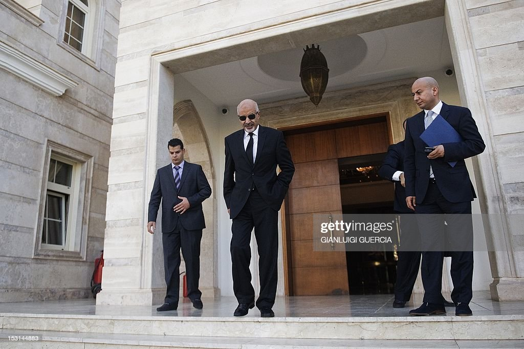 Mohammed Megaryef president of Libya's ruling General National Congress leaves his office to attend a memorial service for the late US Ambassador to...