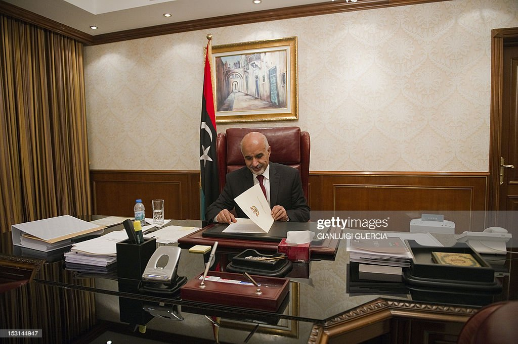 Mohammed Megaryef president of Libya's ruling General National Congress sits at his desk after giving an exclusive interview to the French weekly 'Le...