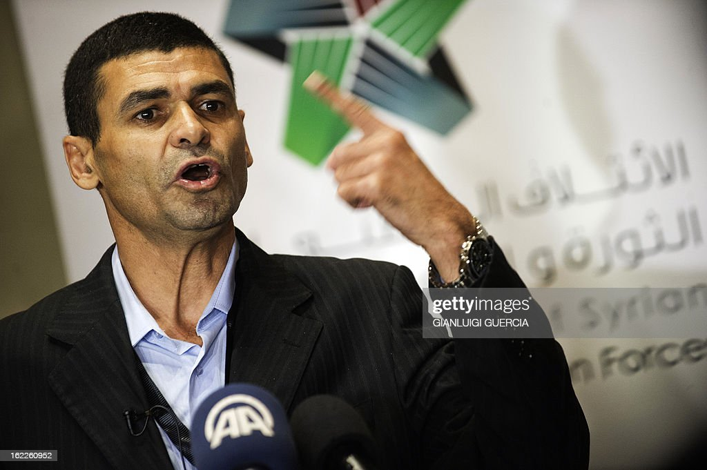 Mohammed Qadah from the Syrian National Council gives a statement to the press on February 21, 2013 following a meeting of the National Coalition of the Syrian opposition in the Egyptian capital Cairo. Syria's main opposition group, the National Coalition, denounced those behind a deadly car bombing in Damascus as 'terrorists', regardless of who carried it out. In a statement posted on Facebook, the Coalition stressed that 'any acts targeting civilians with murder or human rights violations are criminal acts that must be condemned, regardless of the perpetrator or the justification'.