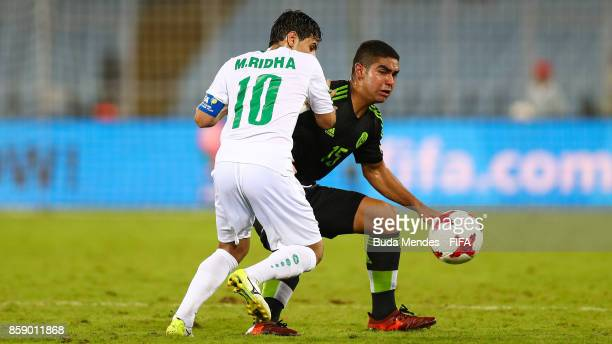 Mohammed Ridha of Iraq battles for the ball with Alan Maeda of Mexico during the FIFA U17 World Cup India 2017 group F match between Iraq and Mexico...