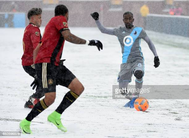 Mohammed Saeid of Minnesota United FC controls the ball against Hector Villalba and Tyrone Mears of Atlanta United FC during the second half of the...