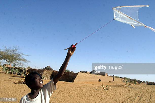 Mohammed Saim the son of Fadul Saim a leader of the Zayadia Arab tribe flies his kite in the middle of the road dividing the Arab and African...