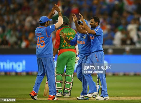 Mohammed Shami and of India celebrate the wicket of Mohammad Mahmudullah of Bangladesh during the 2015 ICC Cricket World Cup match between India and...
