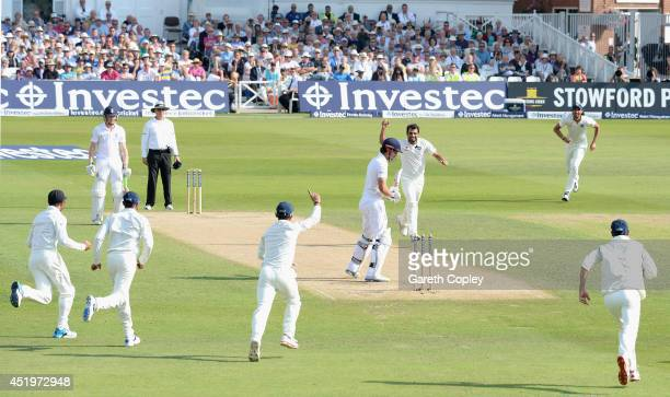 Mohammed Shami of India celebrates bowling England captain Alastair Cook during day two of 1st Investec Test match between England and India at Trent...