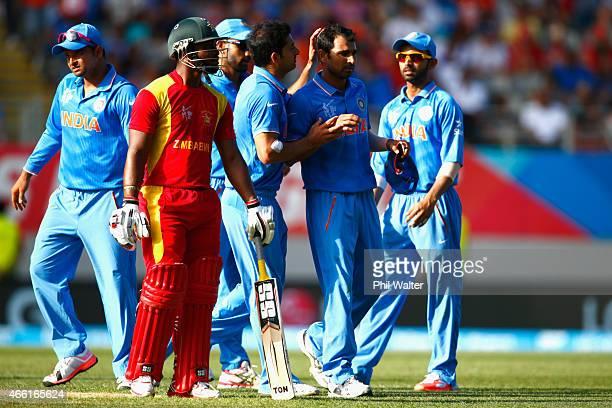 Mohammed Shami of India celebrates his wicket of Sikandar Raza of Zimbabwe during the 2015 ICC Cricket World Cup match between India and Zimbabwe at...