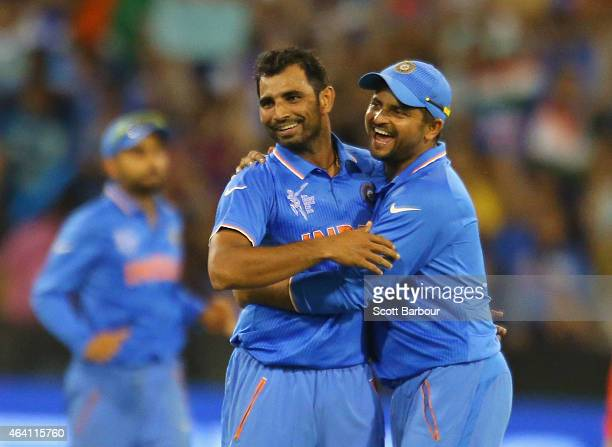 Mohammed Shami of India celebrates with Suresh Raina after dismissing Dale Steyn of South Africa during the 2015 ICC Cricket World Cup match between...