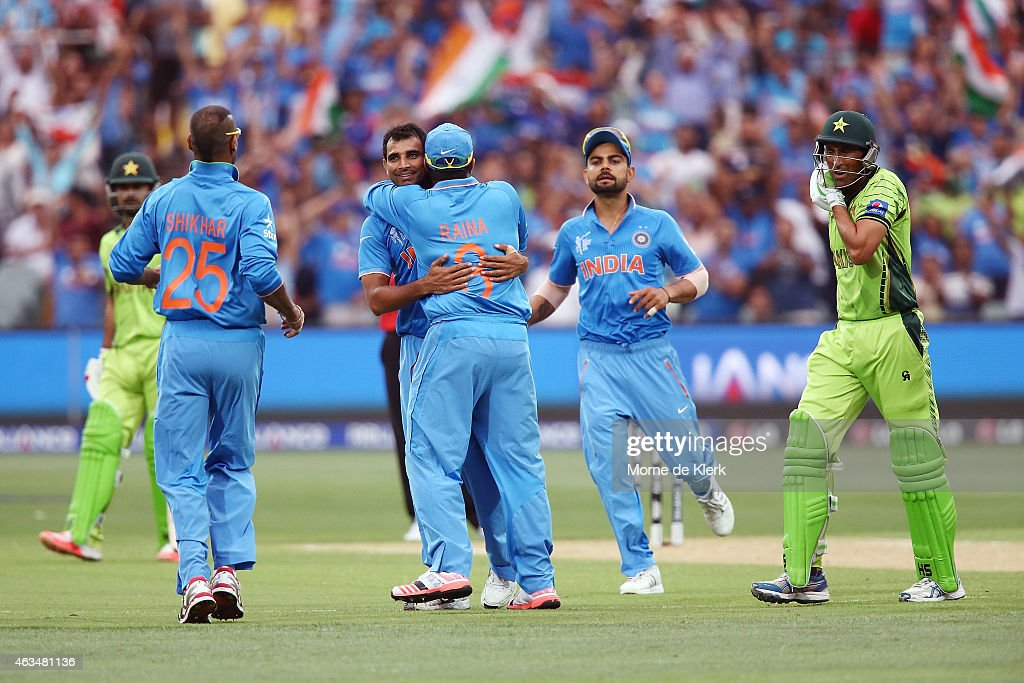 <a gi-track='captionPersonalityLinkClicked' href=/galleries/search?phrase=Mohammed+Shami&family=editorial&specificpeople=11209297 ng-click='$event.stopPropagation()'>Mohammed Shami</a> of India is congratulated by teammates after he got the wicket of Younus Khan of Pakistan during the 2015 ICC Cricket World Cup match between India and Pakistan at Adelaide Oval on February 15, 2015 in Adelaide, Australia.