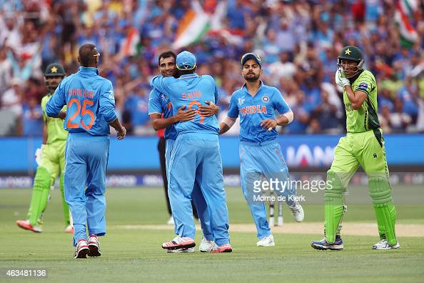Mohammed Shami of India is congratulated by teammates after he got the wicket of Younus Khan of Pakistan during the 2015 ICC Cricket World Cup match...