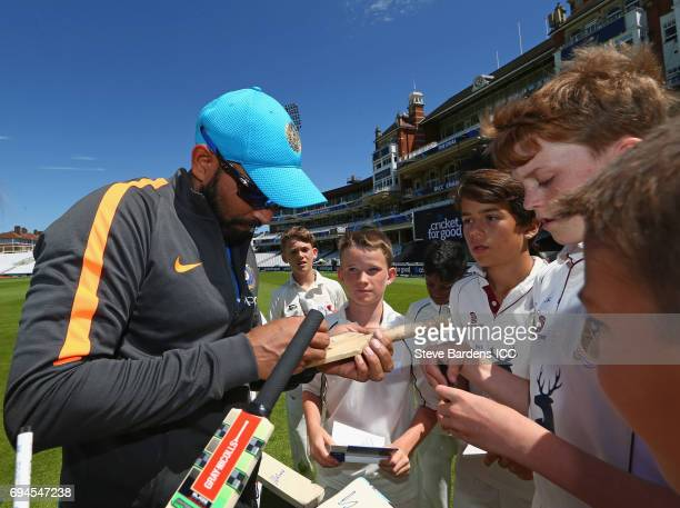 Mohammed Shami of India signs autographs for local children playing during the ICC Cricket For Good coaching session with India at The Kia Oval on...