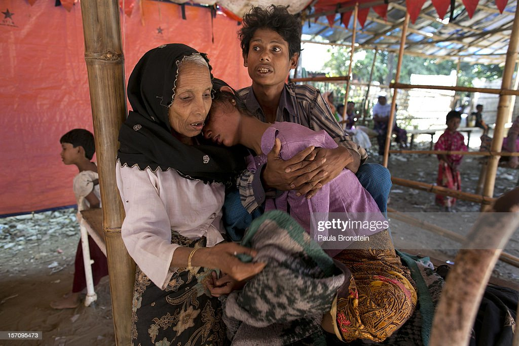 Mohammed Shamim (R) holds his sick wife Mumtaz as her mother comforts her at a government run medical clinic November 25, 2012 on the outskirts of Sittwe, Myanmar. Mumtaz was later taken to the local hospital. An estimated 111,000 people were displaced by sectarian violence in June and October, effecting mostly the ethnic Rohingya people, who are now living in crowded IDP camps racially segregated from the Rakhine Buddhists in order to maintain stability. Around 89 lives were lost during a week of violence in October, the worst in decades. As of 2012, 800,000 Rohingya live in Myanmar. According to the UN, they are one of the most persecuted minorities in the world.