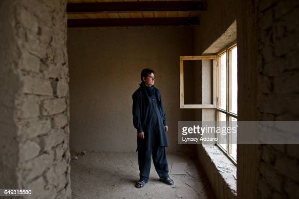 Mohammed Sharif stands in the empty home he left after one year in the mostly abandoned land allocation settlement of AliceGhan about 30 miles...