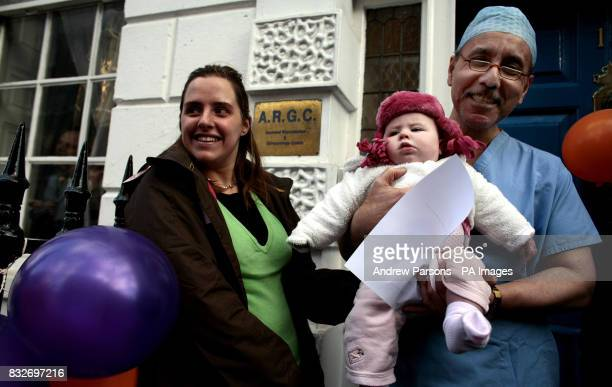 Mohammed Taranissi holds Madeleine Cohen six months from Bournemouth during a mothers and babies Protest Party to demonstrate against the Panorama...