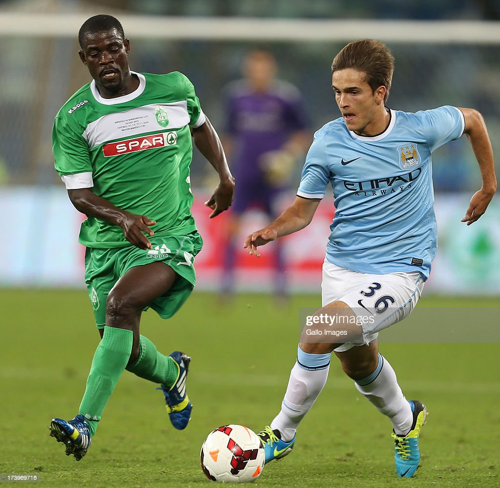 Mohammed-Awal Issah of AmaZulu looks to tackle Denis Suarez of Manchester City on attack during the Nelson Mandela Football Invitational match between AmaZulu and Manchester City at Moses Mabhida Stadium on July 18, 2013 in Durban, South Africa.