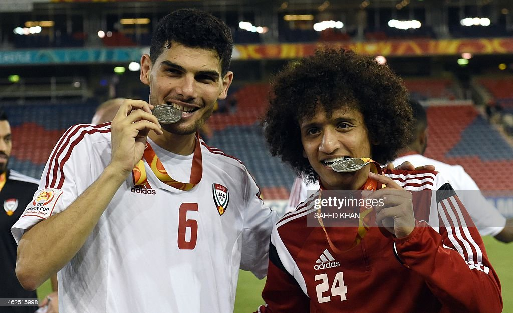 Mohanad Salem (L) and <a gi-track='captionPersonalityLinkClicked' href=/galleries/search?phrase=Omar+Abdulrahman&family=editorial&specificpeople=6420654 ng-click='$event.stopPropagation()'>Omar Abdulrahman</a> (R) of United Arab Emirates celebrate with their third-place medals after the third-place play-off football match between Iraq and United Arab Emirates at the AFC Asian Cup in Newcastle on January 30, 2015. AFP PHOTO / Saeed Khan --IMAGE