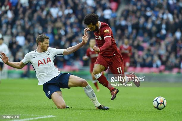 Mohaned Salah of Liverpool with Jan Vertonghen of Tottenham during the Premier League match between Tottenham Hotspur and Liverpool at Wembley...