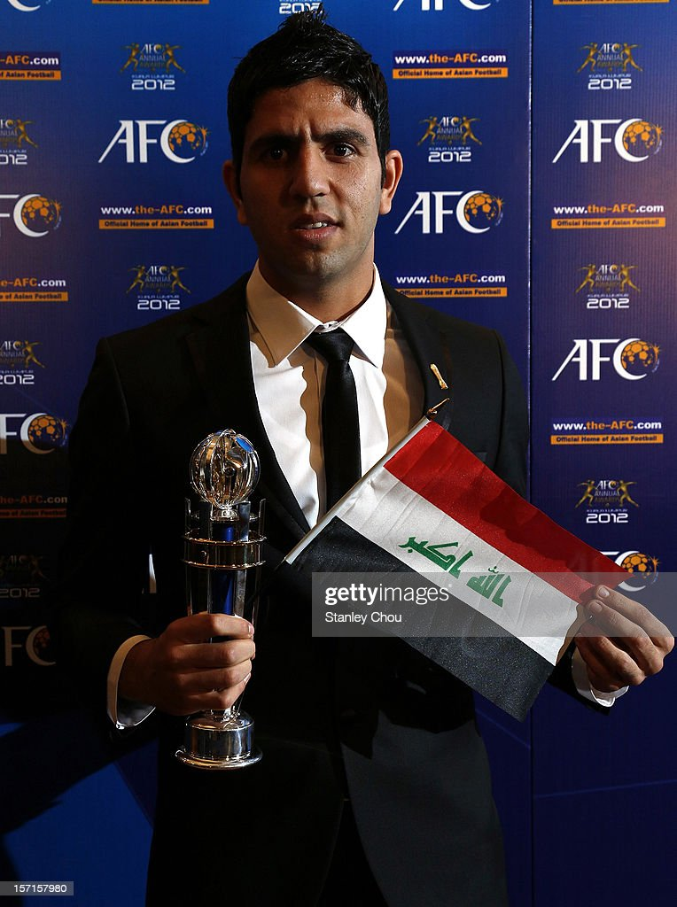 Mohannad Abdul-Raheem Karrar of Iraq shows off the prestigious accolade award of the 2012 AFC Youth Player of the Year Award during the 2012 AFC Annual Awards at the Mandarin Oriental Hotel on November 29, 2012 in Kuala Lumpur, Malaysia.