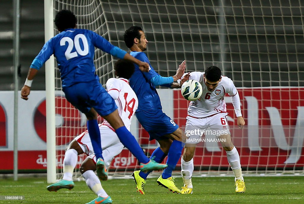 Mohannad Salem (R) of United Arab Emirates heads the ball ahead of Fahed al-Rashidi (C) of Kuwait during the two teams semi final match in the 21st Gulf Cup in Manama, January 15, 2013. UAE won 1-0.