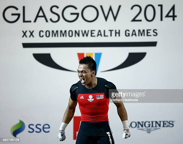 Mohd Hafifi Mansor of Malaysia celebrates in the Men's 69kg weightlifting final at the Clyde Auditorium during day three of the Glasgow 2014...