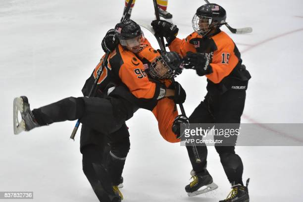 Mohd Hariz Moh Oryza Aqfar Naeem and Muhammad Syukri Sharudin celebrate a goal during their round robin ice hockey game against the Philippines...