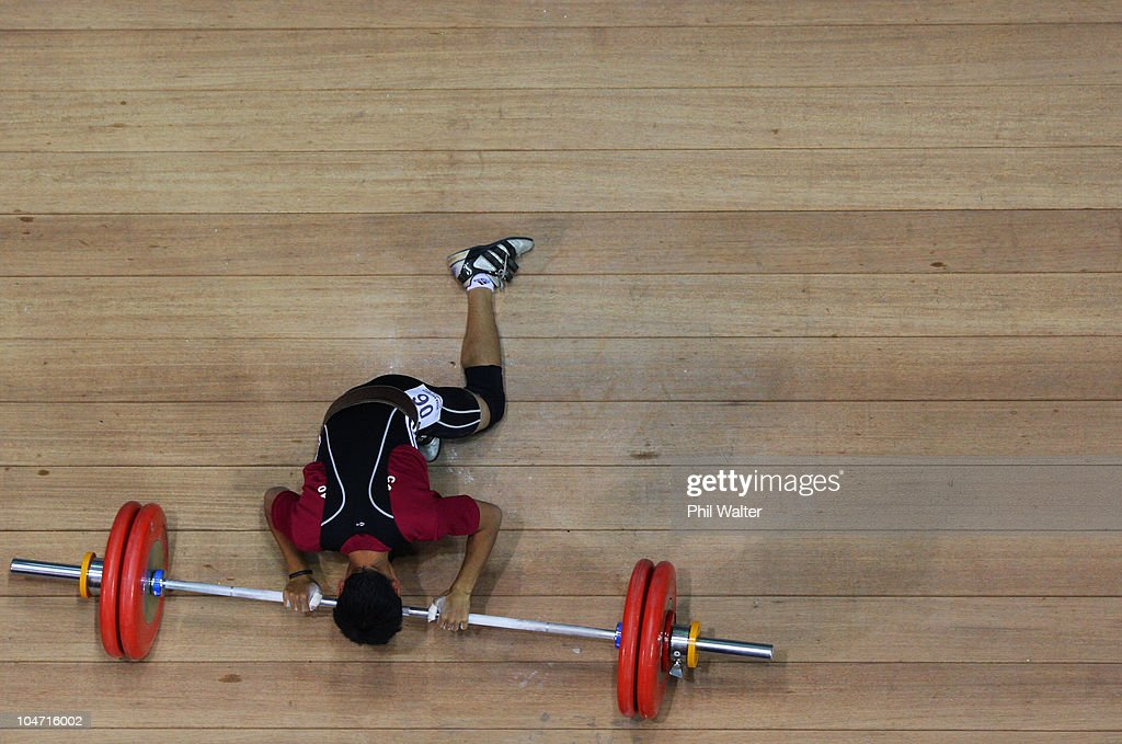 Mohd Shafiq Ismail of Malaysia reacts after an attempt in the Mens 56 kg weightlifting final during day one of the Delhi 2010 Commonwealth Games at Jawaharlal Nehru Sports Complex on October 4, 2010 in Delhi, India.