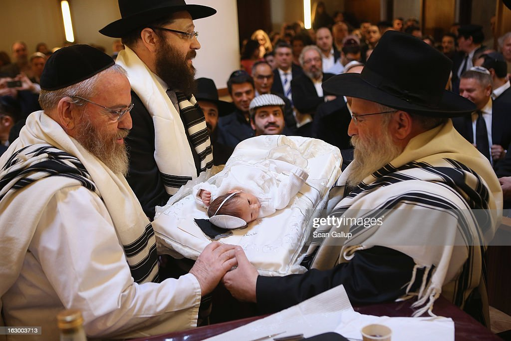 Mohel Manachem Fleischmann (L) prepares to circumcise baby infant Mendl Teichtal at the Chabad Lubawitsch Orthodox Jewish synagogue on March 3, 2013 in Berlin, Germany. Germany's parliament, the Bundestag, passed a law affirming the legality of circumcision in December after a Cologne court called the practice into question in May of 2012, a ruling that sparked outrage among Germany's Jewish and Muslim population.