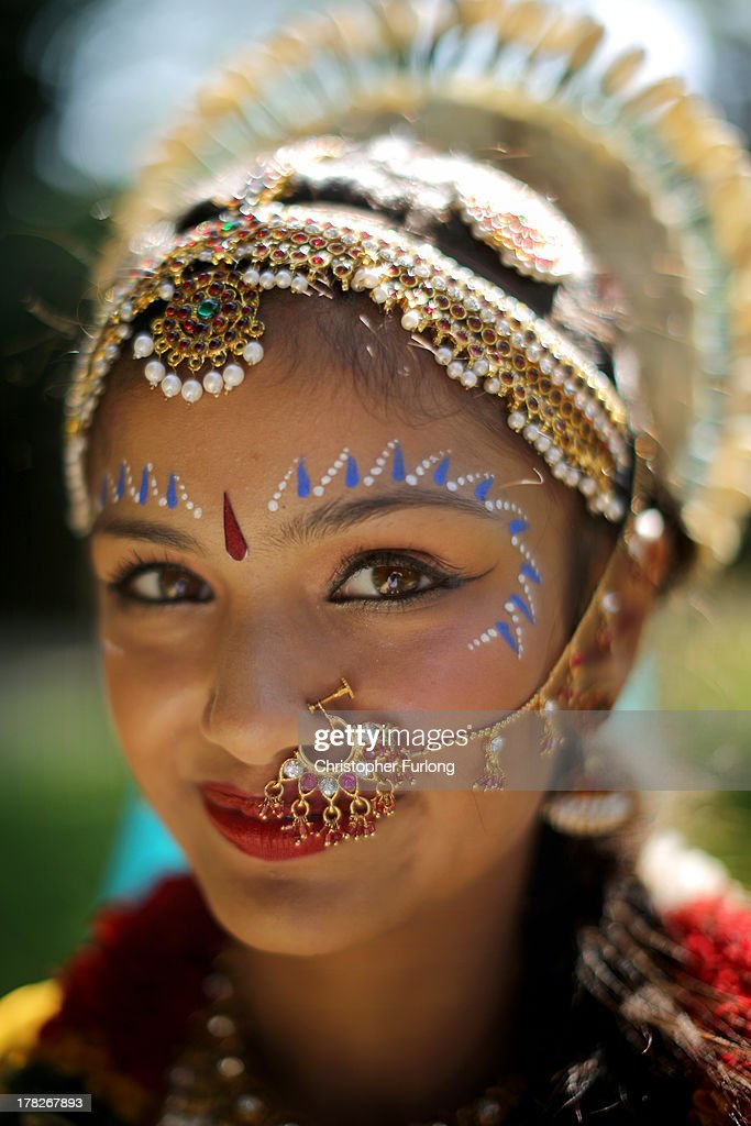 Mohini Patel, aged 13, dressed as Lord Krishna's devotee Radharani, poses during the Janmashtami Hindu Festival at Bhaktivedanta Manor on August 28, 2013 in Watford, England. Up to 72,000 were expected to take part in the Hindu festival of 'Janmashtami', which falls on August 28 this year, and marks the birth of the Hindu god Lord Krishna. The festival is believed to be the largest Hindu festival gathering outside of India. Bhaktivedanta Manor is also celebrating it's 40th year since the manor house was donated to the Society of Krishna Consciousness by George Harrison in 1973.
