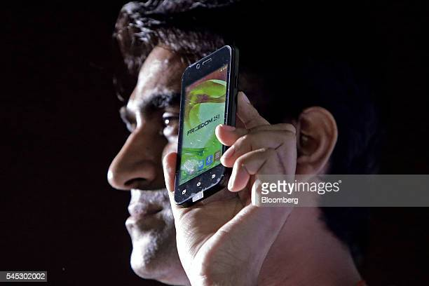 Mohit Goel managing director of Ringing Bells Pvt holds a Freedom 251 smartphone during a news conference in New Delhi India on Thursday July 7 2016...