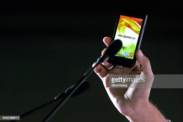 Mohit Goel managing director of Ringing Bells Pvt holds the Freedom 251 smartphone during a news conference in New Delhi India on Thursday July 7...