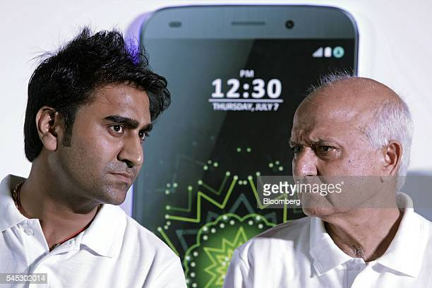 Mohit Goel managing director of Ringing Bells Pvt left and Ashok Chadha president attend a news conference for the Freedom 251 smartphone in New...