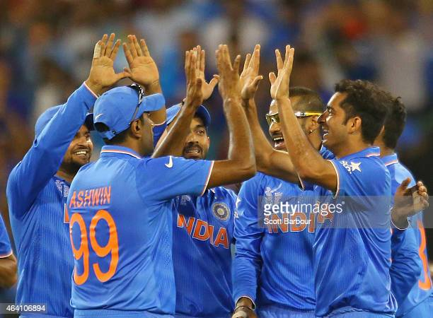 Mohit Sharma of India celebrates with his teammates after running out AB de Villiers of South Africa during the 2015 ICC Cricket World Cup match...