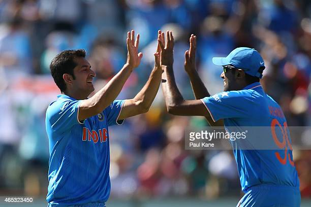 Mohit Sharmar and Ravichandran Ashwin of India celebrate the dismissal of Chris Gayle of the West Indies during the 2015 ICC Cricket World Cup match...