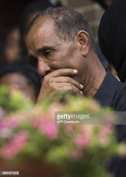 Mohmoud Hassanen the father of Nabra Hassanen grieves during a vigil in Sterling Virginia on June 21 2017 The 17yearold Muslim girl was killed with a...