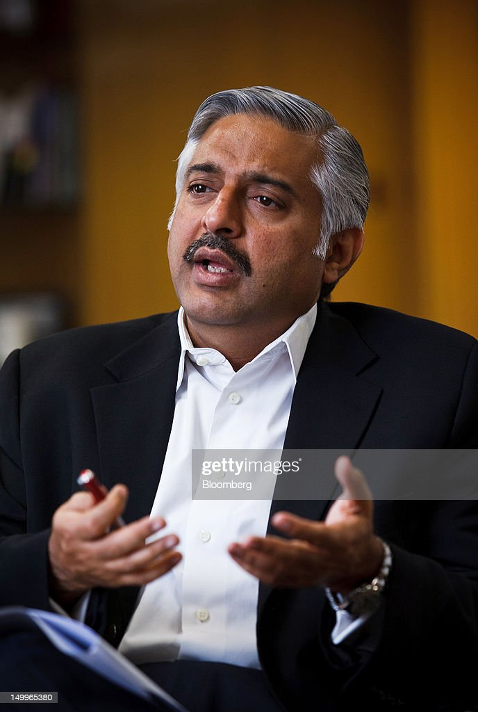 Mohsin Ali Nathani, chief executive officer of Standard Chartered Bank Pakistan Ltd., gestures while he speaks during an interview in Karachi, Pakistan, on Tuesday, Aug. 7, 2012. Pakistan banks' profit growth may slow over the next three years as blackouts and war on the country's borders weigh on companies' appetite to borrow and invest, according to Standard Chartered. Photographer: Asim Hafeez/Bloomberg via Getty Images