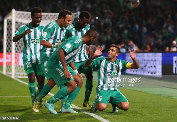 Mohsine Moutaouali of Raja Casablanca celebrates with team mates after scoring from the penalty spot during the FIFA Club World Cup Semi Final match...